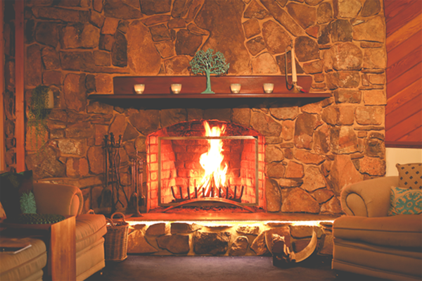 Retreat Lounge with open stone fire place, vinyls, books, dvds and colour therapy books.