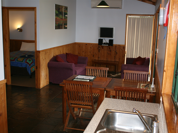 Dining/Lounge/Master Bedroom in Lavender & Orchard Cottages