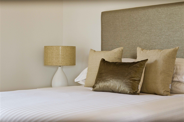 Pristine white sheeting, soft pillows and luxurious pillow topped beds.