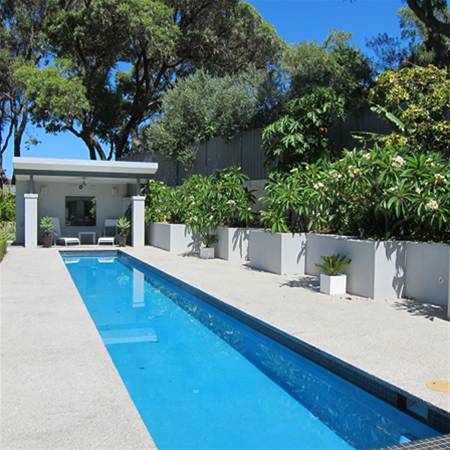 Lap pool with cabana, edged with frangipanis