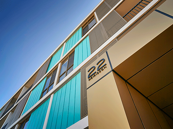 The Mika Apartments at South Beach for Match Property features copper panels on the facade.