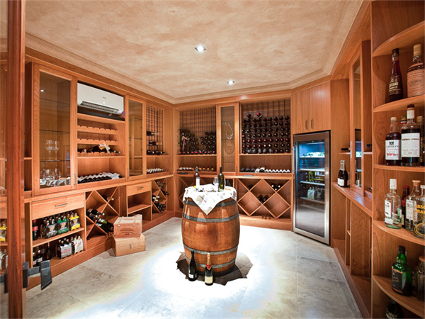 A cellar by Fogliani Interiors.