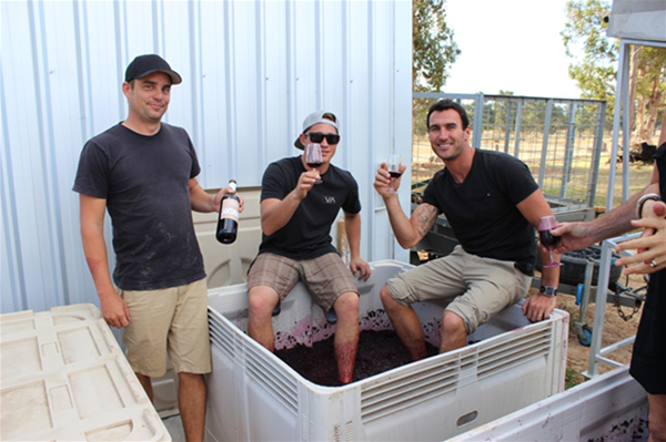 World champion surfer Joel Parkinson and crew stomping grapes on a private charter
