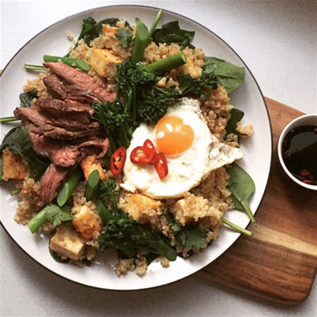 Major & Morsel Food Co rib eye steak w. spiced quinoa & tofu, topped w. a perfectly fried egg