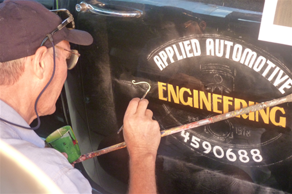 Painted logo with scrolls for restored Chevy ute.