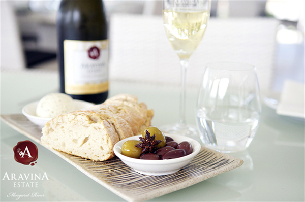 Aravina Vintage Sparkling with our freshly baked bread, truffle butter and marinated olives