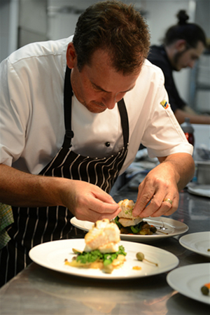 Aravina Estate executive chef Tony Howell putting the final touches on one of his magnificent dishes