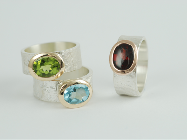 Sterling silver rings with 9ct yellow gold and semi-precious stones