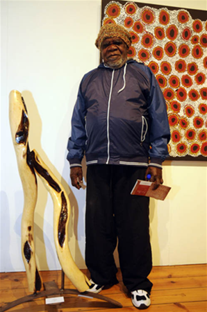 Artist Fred Grant with sculpture