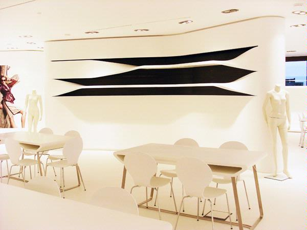 Staron® Bright White tables, chairs and wall panel display