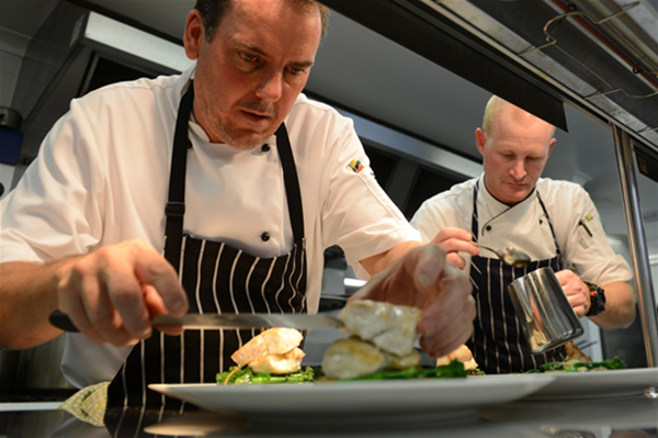 Chefs plating up food for an event