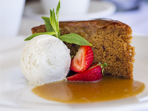 Sticky Date Pudding glazed with Butterscotch Sauce served with Vanilla Ice Cream
